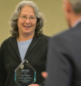 Amy Shapiro holding award from MACDC